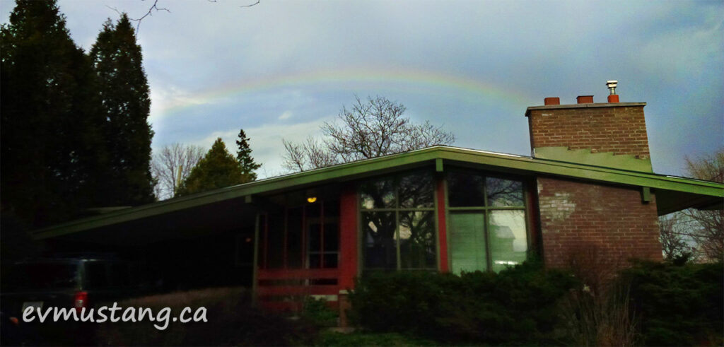 image of rainbow over suburban house in london, ontario