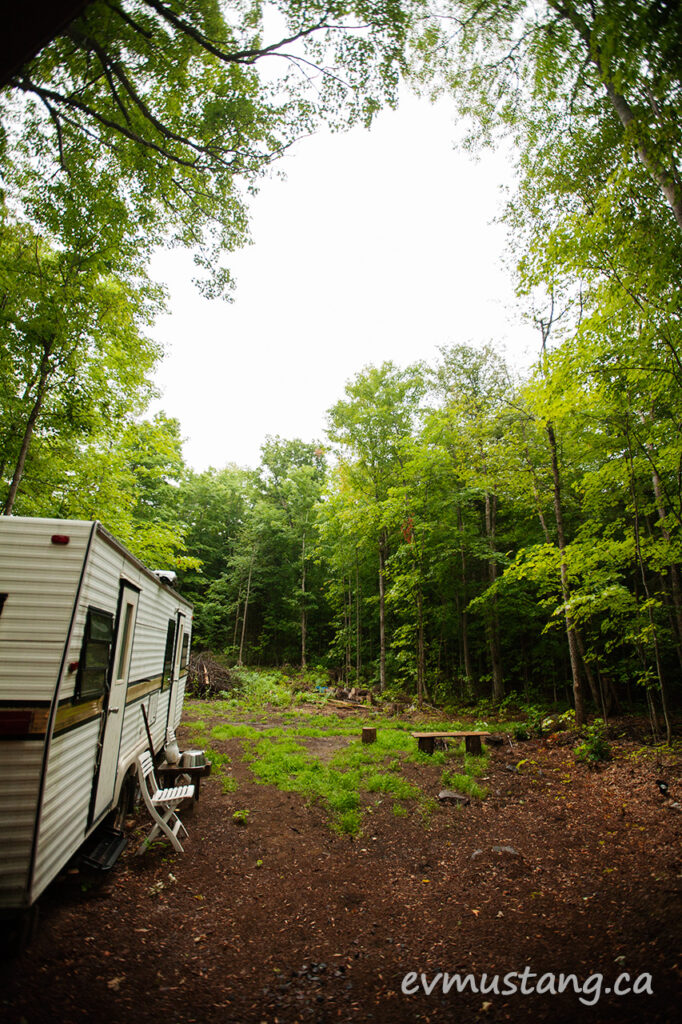 image of trailer in a clearing in a central ontario maple forest