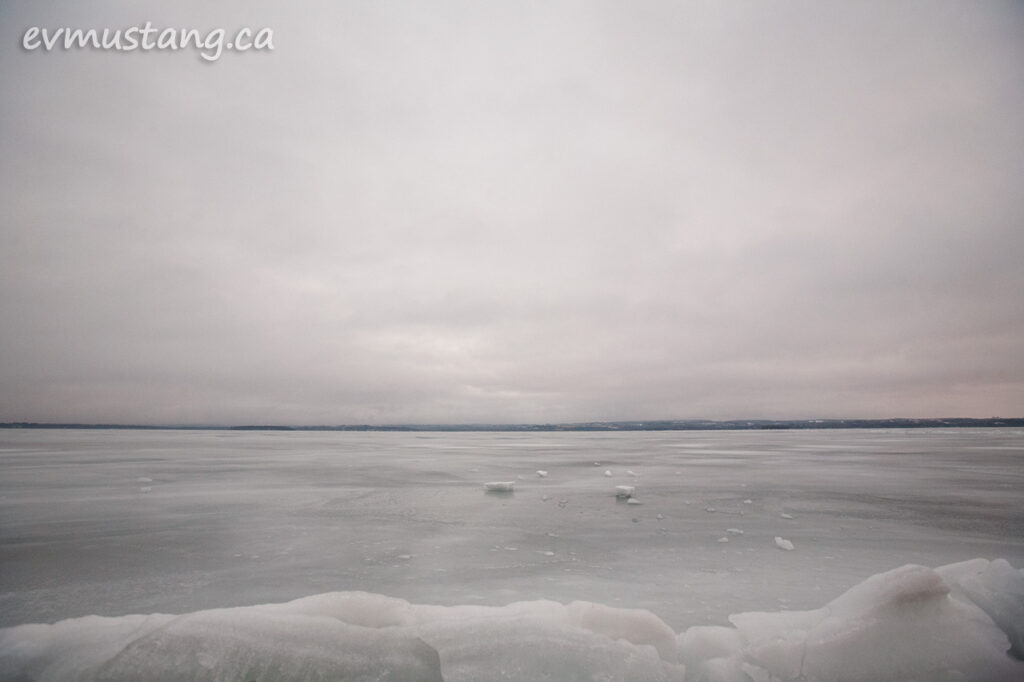 image of chunks of ice crust on rice lake under sun warmed cloud cover