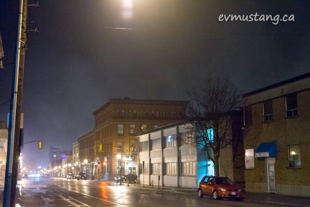 image of parked car on water street in the fog. this image makes me think of an edward hopper painting