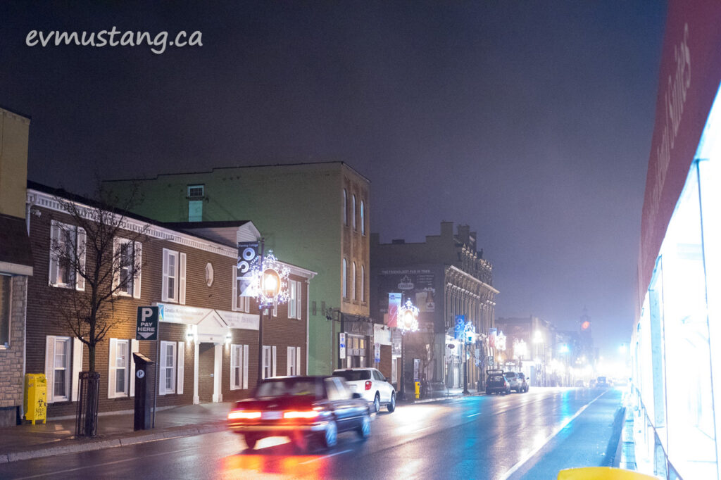 image of peterborough george street with taffic, fog and many different colours of lights