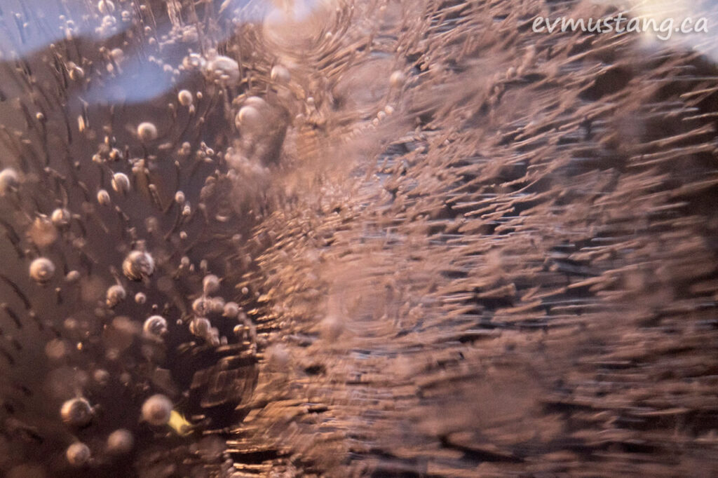 extreme close up image of bubbles trapped in ice