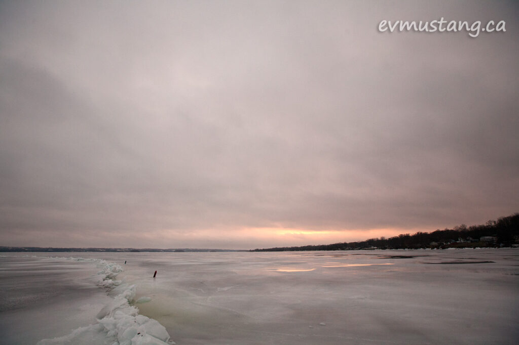 image of sunset reflected in the ice on rice lake