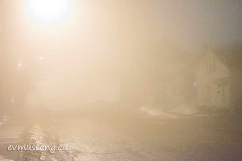 image of barely visible street blanketed by dense fog